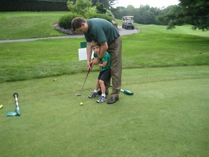 Nicholas with his dad at Farms Country Club Golf Tournament
